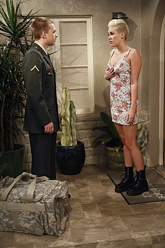 'You Know What the Lollipop is For'--Jake (Angus T. Jones, left) meets Missi (special guest star Miley Cyrus, right) at Walden�s house, on TWO AND A HALF MEN, Thursday, Oct. 18 (8:30-9:00 PM, ET/PT) on the CBS Television Network.  Photo: Greg Gay at First Look at Miley Cyrus on TWO AND A HALF MEN