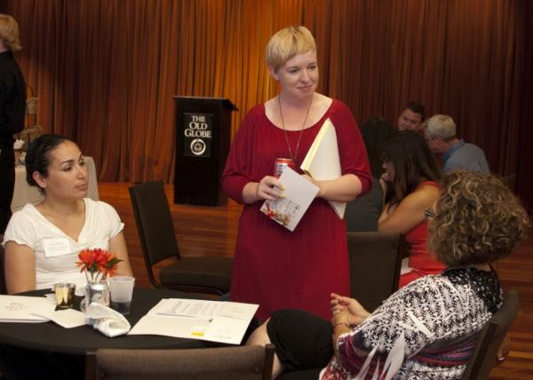 Teaching artist Katherine Harroff with community members