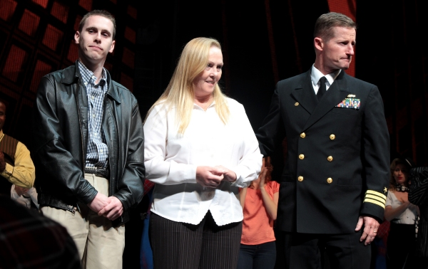 Command Master Chief Matthew E. Danforth and the family of Michael Murphy Photo