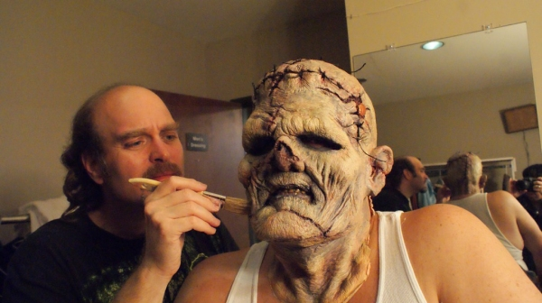 Phil Nichols applying The Creature Make-Up on Michael Raabe. Photo