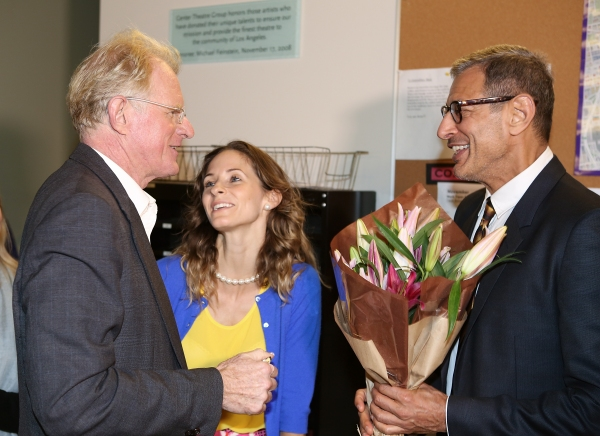 From left, cast member Ed Begley, Jr. is presented flowers by Emilie Livingston and a Photo