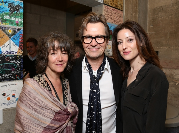 "From left, Anwen Rees-Myers, actor Gary Oldman and wife Alexandra Edenborough pose backstage after the opening night performance of ""Krapp's Last Tape"" at Center Theatre Group's Kirk Douglas Theatre on Wednesday,  Oct. 10, 2012, in Culver City, Calif. (Ph"
