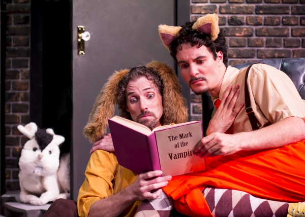 Harold the dog (Stephen Hurst) and Chester the Cat (Braden Hunt) read up on the new rabbit Bunnicula
