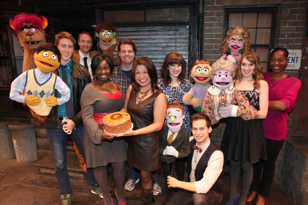The cast of 'Avenue Q' (L to R) Darren Bluestone (Princeton), Rob Morrison (Trekkie), Danielle K. Thomas, Nicholas Kohn, Hazel Anne Raymundo, Veronica Kuehn (Kate Monster), Jed Resnick (Rod), Lexy Fridell (Mrs. T), Robin S. Walker (Lucy) celebrating the