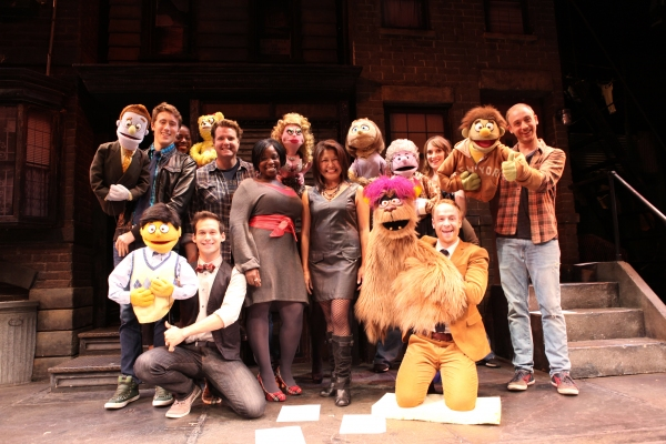 The cast of 'Avenue Q' (L to R)  Darren Bluestone, Robin S. Walker, Jed Resnick, Nicholas Kohn, Danielle K. Thomas, Hazel Anne Raymundo, Veronica Kuehn, Lexy Fridell, Rob Morrison and Michael Liscio Jr. filming a PSA in support of the Public Broadcastin