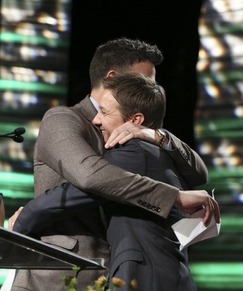 From left, Ben Affleck, Career Achievement Award winner hugs presenter Jeremy Renner during the 2012 Casting Society of America Artios Awards held at the Beverly Hilton Hotel on Monday Oct. 29, 2012 in Beverly Hills, Calif. (Photo by Ryan Miller/Capture I