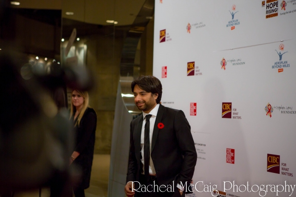 Host Jian Ghomeshi at Annie Lennox, Sarah McLachlan and Angelique Kidjo at HOPE RISING