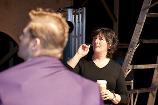 Director Sarah Shippobotham giving direction to actor Justing Tsatsa during rehearsal
