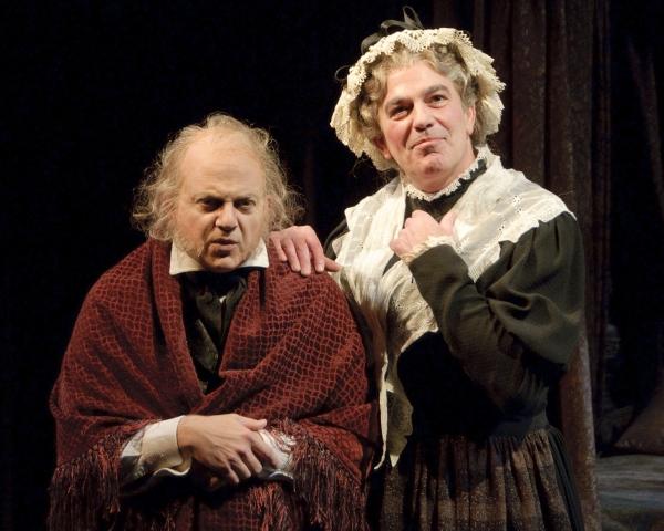 Jeffrey Bean as Ebenezer Scrooge and John Feltch as Mrs. Dilber Photo