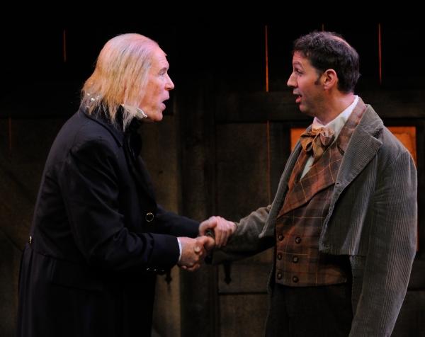 Timothy Crowe as Ebenezer Scrooge and Mauro Hantman as Bob Cratchit Photo