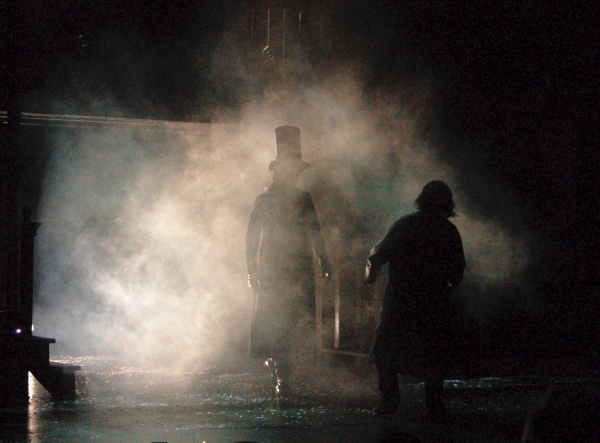 JASON LILES as Spirit of Christmas Future; WILBUR EDWIN HENRY as Ebenezer Scrooge