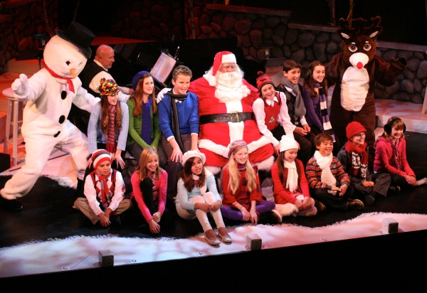 Snowman, Ken Jones as Santa Claus and Rudolph with youth chorus, front row left to right; Xander Young and Emilee Krablin from Ventura, Alexis Neumann from Thousand Oaks, Sydney Unseth and McKenna Tedrick from Camarillo, Daniel Brackett from Ventura, Mich