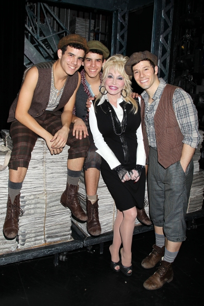 -New York, NY - 11/28/12 - Dolly Parton Visits the Cast of NEWSIES after catching the November 28th performance.-PICTURED: Jacob Guzman, David Guzman, Dolly Parton and Thayne Jasperson-PHOTO by: Dave Allocca /StarPix-Filename: DA48549130-Location: Nederla at Dolly Parton Visits NEWSIES!