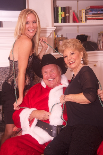Danica Dawn Johnston and Grace Givens with Jim Salners as a Texan Santa Claus.