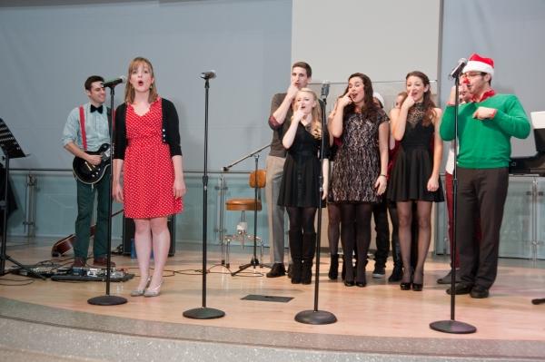 "Mollie McComb singing ""Rudolph the Red Nose Reindeer"" with Megan Morgan, Alexandra Ferrara, Brittney Bertier, Jason Evans, Joel Dommel, and James L'Esperance"