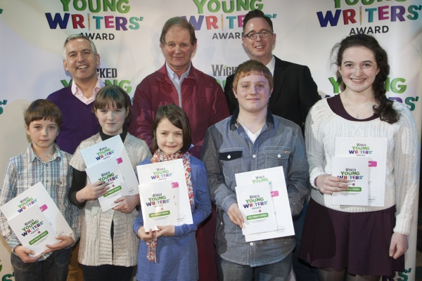 Jack McEwan, Johnathan Douglas, Darcey Fleming, Catherine Solway, Michael Morpurgo, Scott Wilson, Michael McCabe (Executive Producer) and Sophie Max attend The Wicked Young Writers' Award at the Apollo Victoria Theatre, London, England on 6th December 20