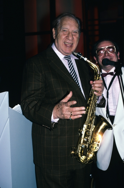 Henny Youngman pictured performing at Cafe Society in New York City. 1988