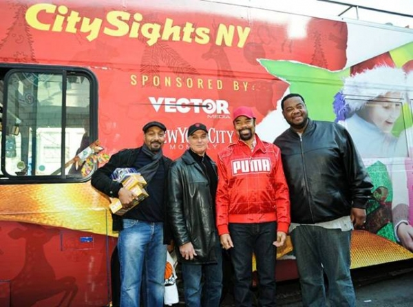 """Jesse L. Martin, Robert Cuccioli, Walt â€Å""""Clydeâ€Â� Frazier and Grizz Chapman joined The Police Athletic League and CitySights NY to bring holiday cheer and toys to hundreds of kids in New York on Saturday"""