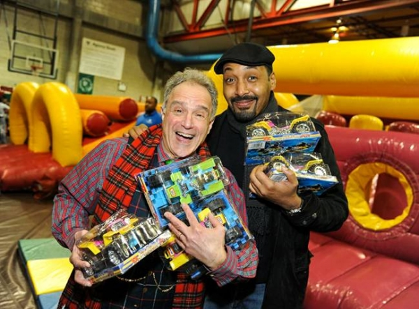 "Jesse L. Martin and �""Boardwalk Empire"" star Anthony Laciura stock up on toys to distribute"