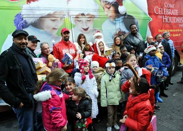 "Jesse L. Martin, Walt ""Clyde"" Frazier, Wendy Williams and more joined The Police Athletic League and CitySights NY to bring holiday cheer and toys to hundreds of kids in New York on Saturday. at Jesse L. Martin, Robert Cuccioli and More Give Back for the Holiday Season"
