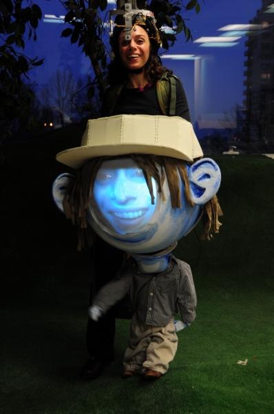 Puppeteer Caroline Tamas as Big Headed Toddler video puppet