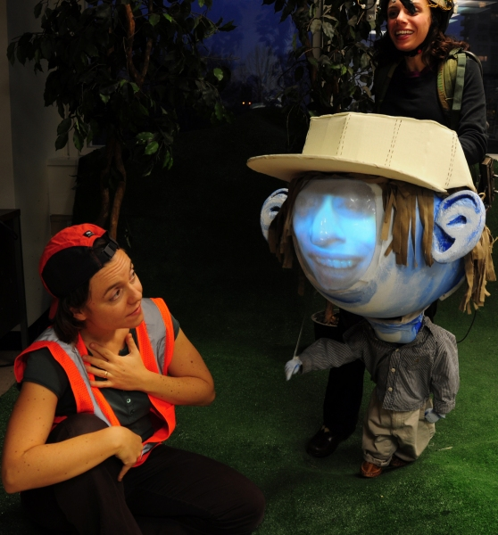 Kalle Macrides as Lia and Puppeteer Caroline Tamas as Big Headed Toddler video puppet