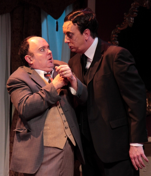 Jonathan Brewster (Jeff Stockberger), right, demands that plastic surgeon Dr. Einstein (Eddie Curry) give him a new face.