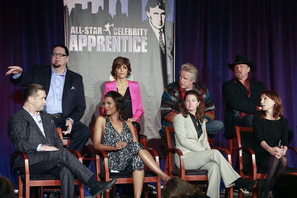 """All-Star Celebrity Apprentice"" -- Pictured: (l-r) Stephen Baldwin, Penn Jillette, Omarosa, Lisa Rinna, Page Feldman, Executive Producer; Gary Busey, Trace Adkins, Marilu Henner"