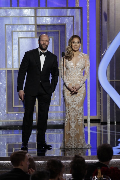 70th ANNUAL GOLDEN GLOBE AWARDS -- Pictured: (l-r) Presenters Jason Statham, Jennifer Lopez on stage during the 70th Annual Golden Globe Awards held at the Beverly Hilton Hotel on January 13, 2013 -- (Photo By: Paul Drinkwater/NBC) at Stars of LES MIS,HOMELAND & More Take the Stage of the 70th Annual Golden Globe Awards
