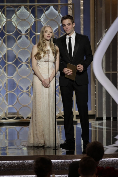 70th ANNUAL GOLDEN GLOBE AWARDS -- Pictured: (l-r) Presenters Amanda Seyfried, Robert Pattinson on stage during the 70th Annual Golden Globe Awards held at the Beverly Hilton Hotel on January 13, 2013 -- (Photo By: Paul Drinkwater/NBC) at Stars of LES MIS,HOMELAND & More Take the Stage of the 70th Annual Golden Globe Awards
