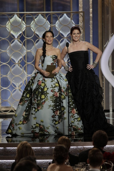 70th ANNUAL GOLDEN GLOBE AWARDS -- Pictured: (l-r) Presenters Lucy Liu, Debra Messing on stage during the 70th Annual Golden Globe Awards held at the Beverly Hilton Hotel on January 13, 2013 -- (Photo By: Paul Drinkwater/NBC) at Stars of LES MIS,HOMELAND & More Take the Stage of the 70th Annual Golden Globe Awards