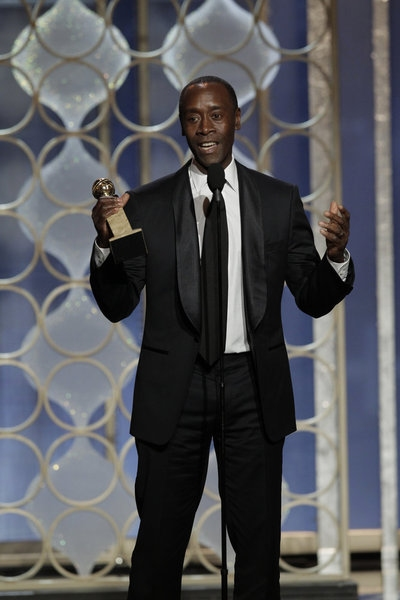 "70th ANNUAL GOLDEN GLOBE AWARDS -- Pictured: Winner, Don Cheadle, Best - TV Series, Comedy or Musical, ""House of Lies"" on stage during the 70th Annual Golden Globe Awards held at the Beverly Hilton Hotel on January 13, 2013 -- (Photo By: Paul Drinkw"