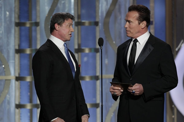 70th ANNUAL GOLDEN GLOBE AWARDS -- Pictured: (l-r) Presenters Sylvester Stallone, Arnold Schwarzenegger on stage during the 70th Annual Golden Globe Awards held at the Beverly Hilton Hotel on January 13, 2013 -- (Photo By: Paul Drinkwater/NBC)