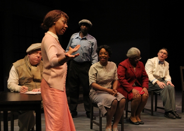 Elder Nellie (seated at center, Greta Oglesby) remembers when she (played by Sh�'¡ Cage) and her co-workers (l to r: Tom Winner, Ron Collier, Lynnea Monique Doublette, and Charles Fraser) discuss what they want to ask for when they meet with the manageme