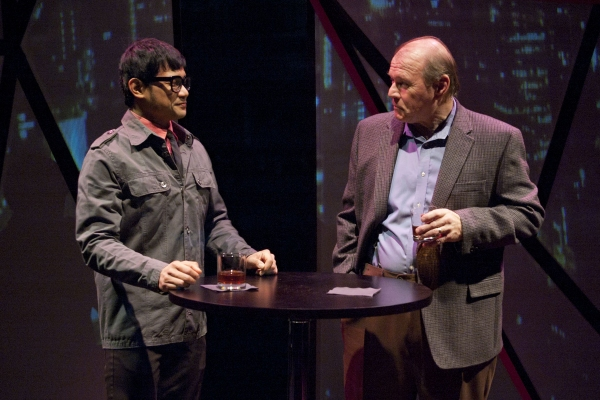 Hiro (Kroydell Galima, left) and Edmund Hewlett (Craig Spidle) talk business over drinks