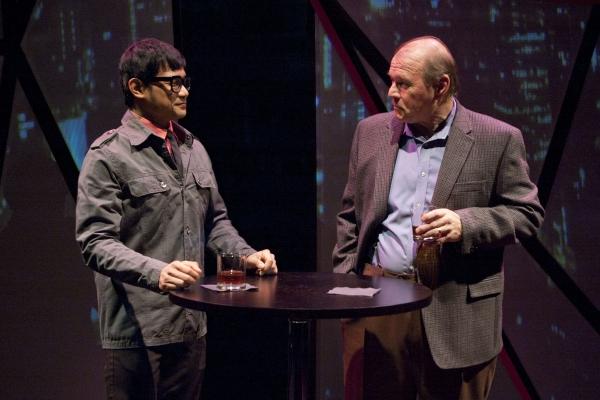 Hiro (Kroydell Galima, left) and Edmund Hewlett (Craig Spidle) talk business over drinks