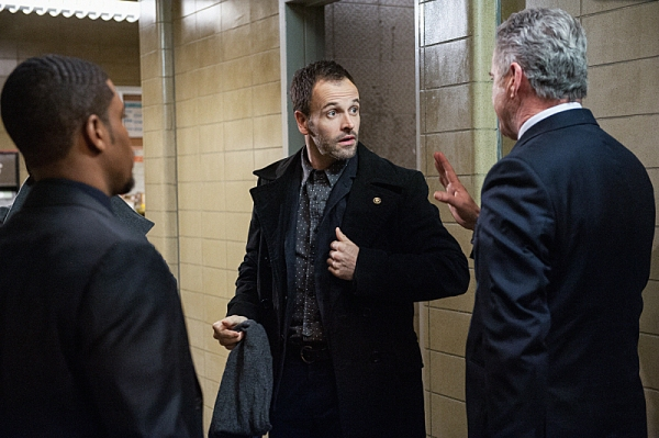 """""""Possibility Two""""--   Sherlock (Jonny Lee Miller, center), Gregson (Aidan Quinn, left) and Bell (Jon Michael Hill (center) investigate a case involving a wealthy philanthropist who believes his incurable illness was given to him on purpose, on ELEMENTARY,"""