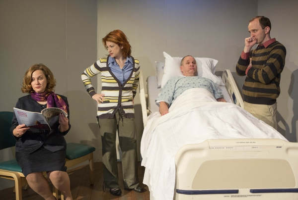 The entire family (L to R) Rita Lyons (Diane Kondrat), Lisa Lyons (Angela Plank), Curtis Lyons (Charles Goad) and Ben Lyons (Scot Greenwell) gathers at the father's bedside.