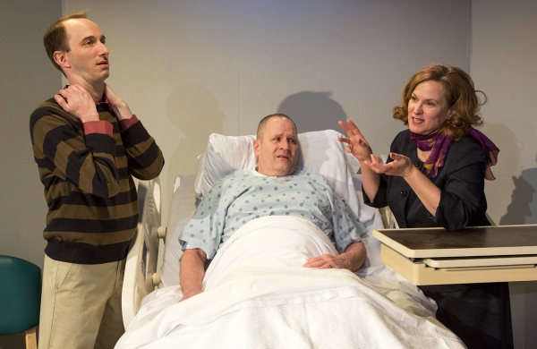 Ben Lyons (Scot Greenwell), his father Curtis Lyons (Charles Goad) and mother Rita Lyons (Diane Kondrat) argue over the father's hospital bed.