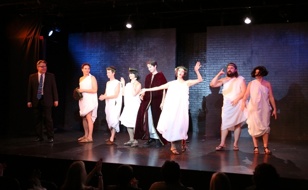 """From left, cast members Pat Towne, Henry Dittman, John Milhiser, Cj Merriman, Jesse Merlin, Erin Matthews, David Haverty and Darrin Revitz take their bow during the curtain call for the world premier of """"Sketches From The National Lampoon"""" at the Hayworth"""