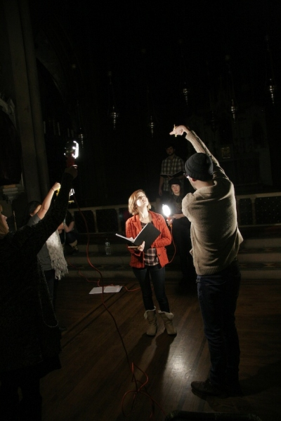 Joe Barros and the cast explore Michael Megliola's actor-manipulated lighting concept. Photo credit: Michael Bonasio.