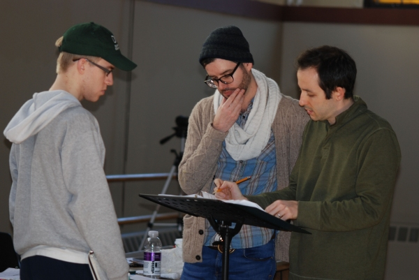 Josh Kelley (Assistant Director) watches as Joe Barros (Director/Choreographer) and Vince Peterson (Music Director) discuss a song moment with intricate rhythms. Photo credit: Elizabeth Ostler.