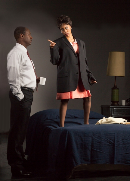 Dr. Martin Luther King, Jr. (Adrian Roberts) looks on as  Lorraine Motel maid Camae (Simone Missick) declares her opinion.