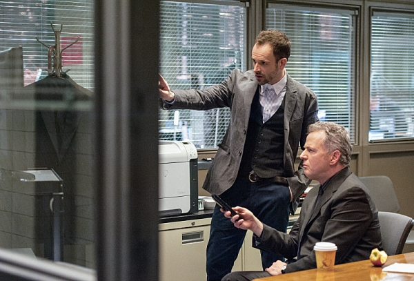 """""""Deja Vu All Over Again""""--   Sherlock (Jonny Lee Miller, right) is intrigued by the subway murder and decides to investigate. Also pictured is Aidan Quinn (left), on ELEMENTARY, on a Thursday, March 14 (10:00-11:00 p.m. ET/PT) on the CBS Television Networ"""