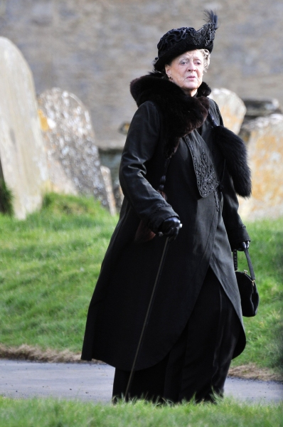 Mandatory Credit: Photo by Joan Wakeham/Rex / Rex USA (1257614d) The Right Honourable Violet Crawley, Dowager Countess of Grantham - Dame Maggie Smith 'Downton Abbey' on set filming, Bampton, Oxfordshire, Britain - 28 Feb 2013 Filming commenced today at