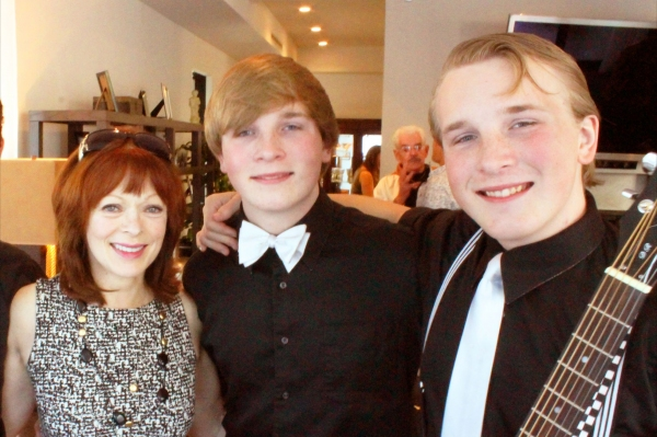 Frances Fisher and two young party performers