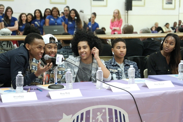 Prodigy, Ray Ray, Princeton and Roc Royal of Mindless Behavior provide feedback to the Childrenâ€s Aid Choir as model Damaris Lewis looks on.