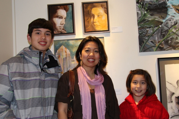 Painter Mic Boekelmann, center, of Princeton, is pictured with her paintings and her children, who served as her models.