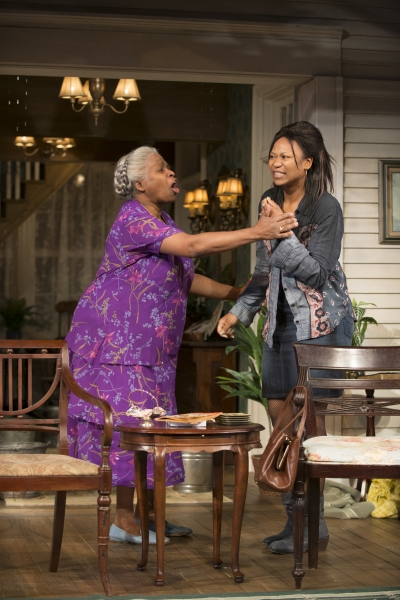 Shelah (Cheryl Lynn Bruce) tries to calm Cookie (ensemble member Alana Arenas) down.