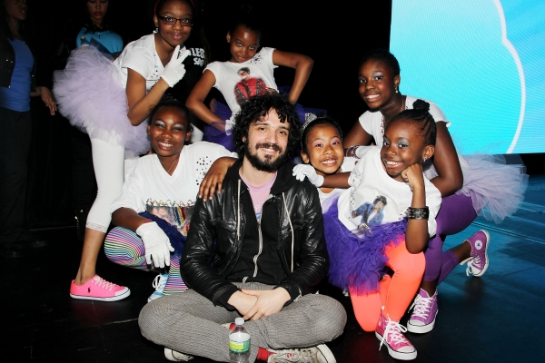 Performers from 'Uniquely Made' of Children's Aid Society with drummer Fabrizio Moretti of The Strokes